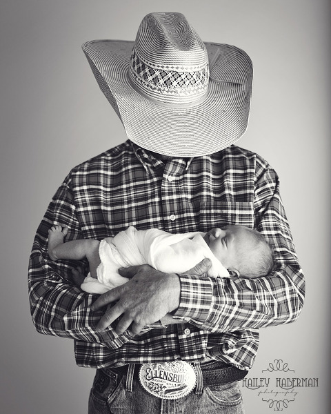 cowboy holding baby boy, rustic and natural posed newborn photography in Ellensburg WA by Hailey Haberman
