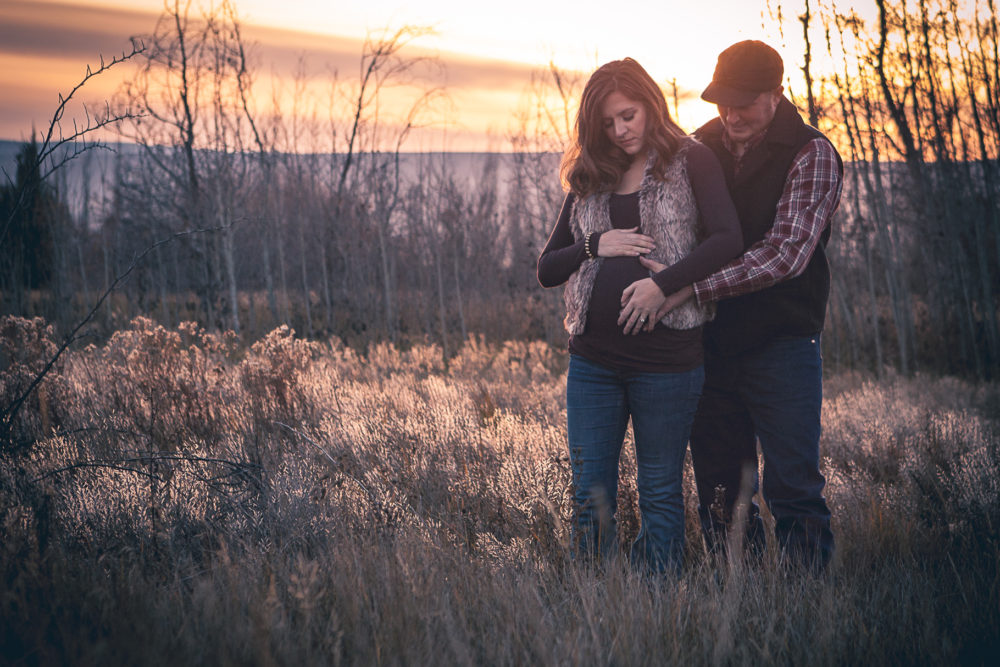 winter maternity couple in field - ellensburg maternity photographer