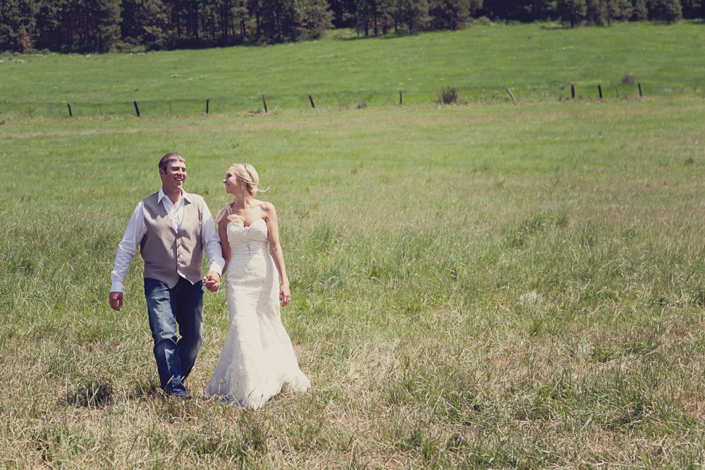 couple walking through open fields - ellensburg wedding photographer