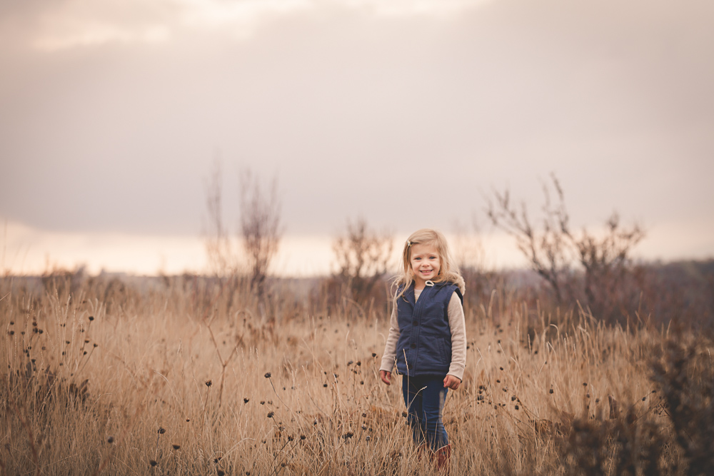 little girl smiling in fall rustic open field - cle elum children photography