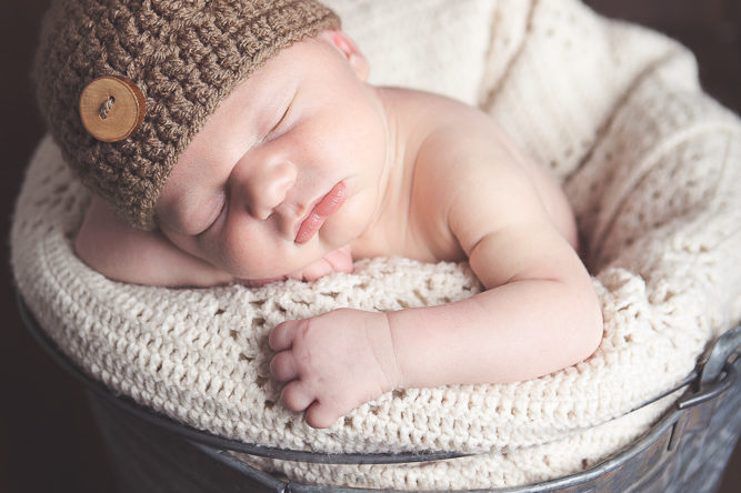 baby boy sleeping in rustic pale - ellensburg newborn photographer