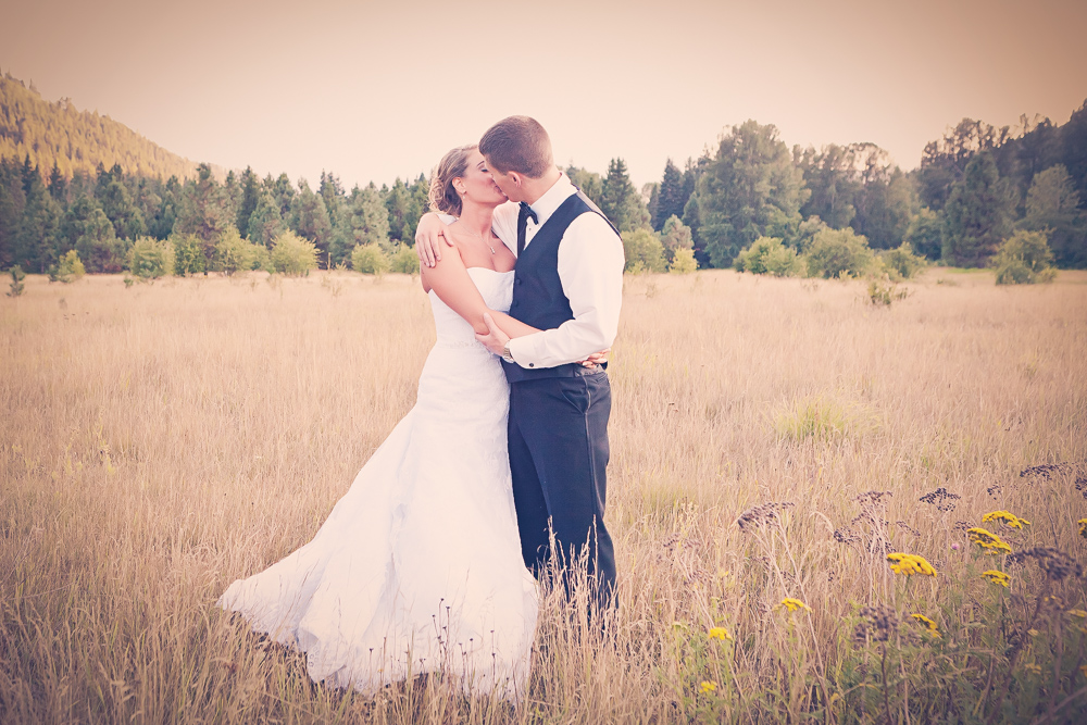 couple hugging in rustic open field - leavenworth wedding photography