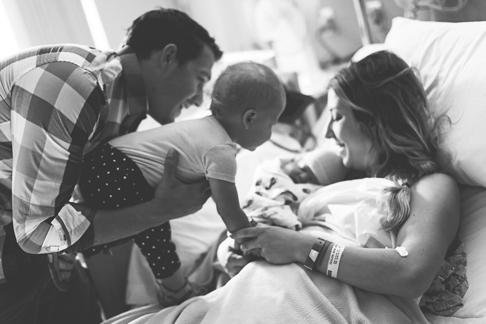 Daddy and sister meeting new baby in hospital - ellensburg hospital photography
