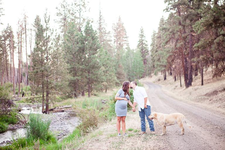 Ellensburg Fall Maternity Photographer captures expecting parents walking through woods