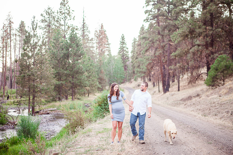 Ellensburg Fall Maternity Photographer captures expecting parents in woods