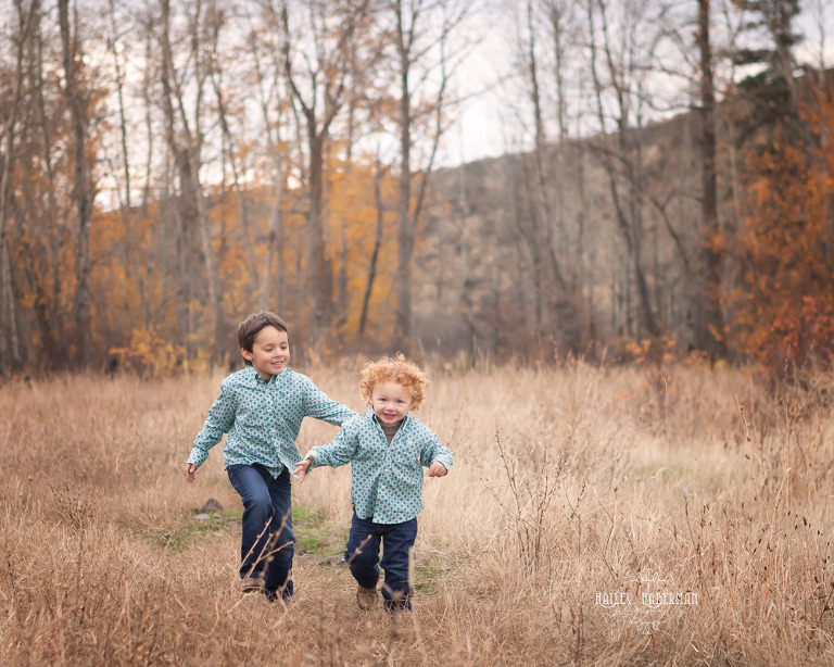 Fall lifesyle family session by Ellensburg Photographer Hailey Haberman with Russ and Danae photo of little boys running through open meadow