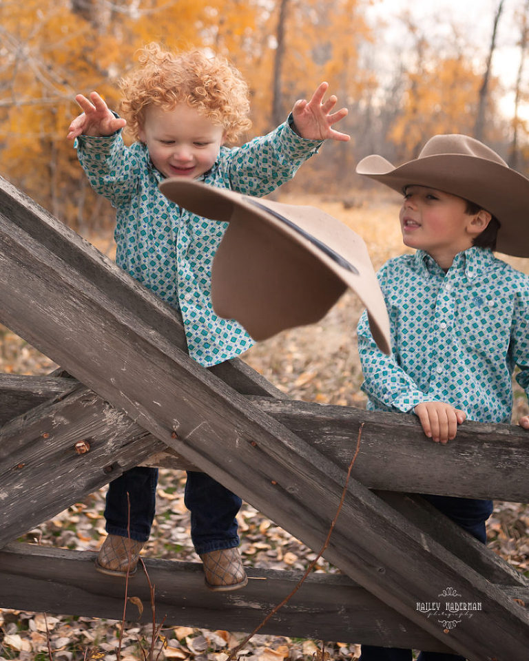 Fall lifesyle family session by Ellensburg Photographer Hailey Haberman with Russ and Danae photo of little boy throwing cowboy hat