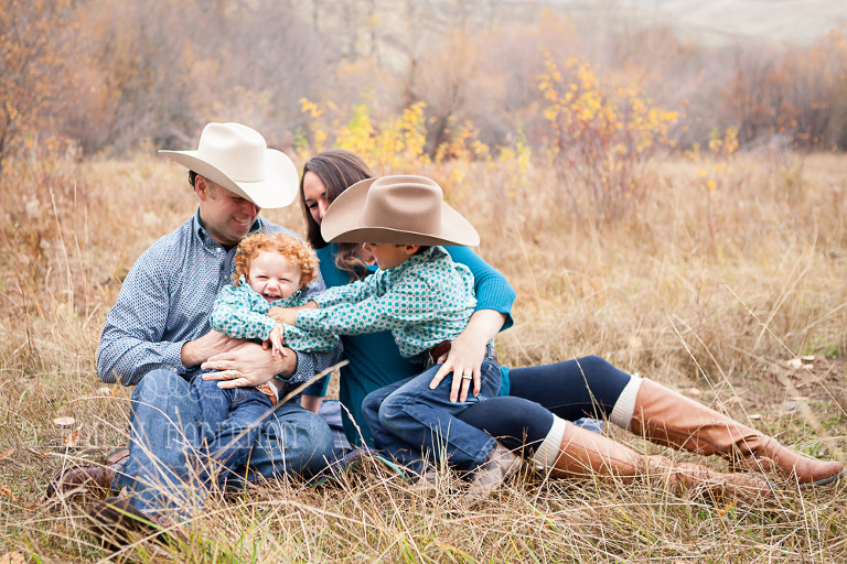 Fall lifesyle family session by Ellensburg Photographer Hailey Haberman with Russ and Danae photo of family laughing