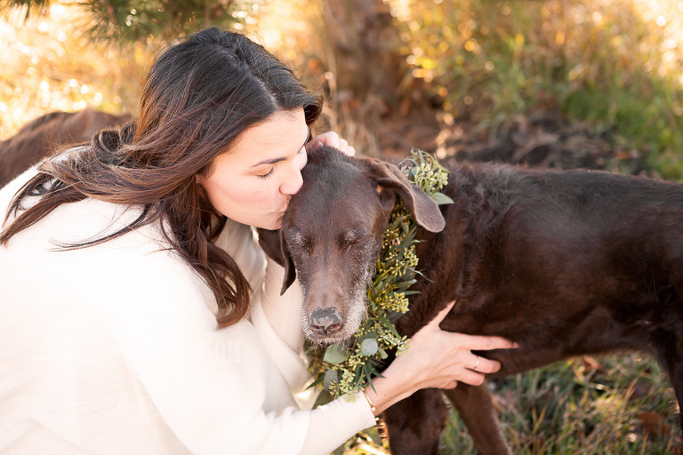 Fall family lifestyle session by Ellensburg Photographer Hailey Haberman with nick and madeline photo of mother kissing dog