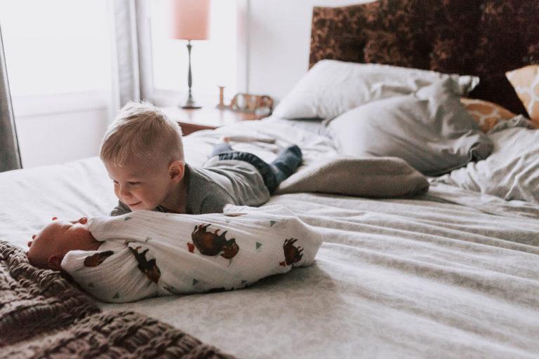 BIg Brother snuggling Baby Miles Ellensburg Lifestyle Newborn Photographer Hailey Haberman