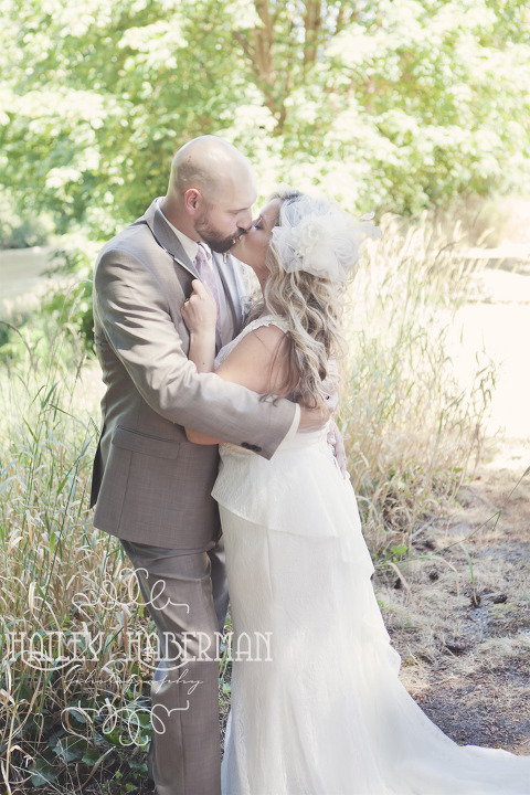 Nisqually Springs Farm Country Wedding candid photo of bride and groom kissing