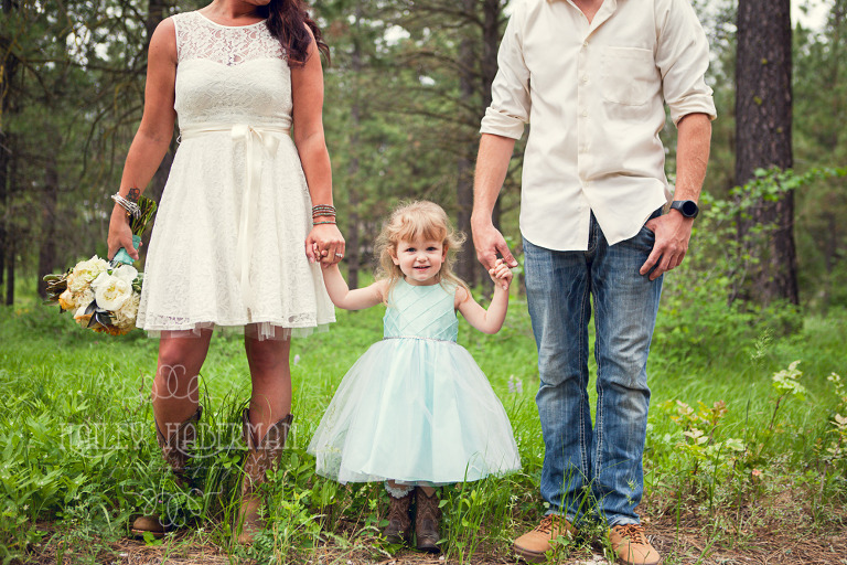bride and groom with daughter, Backyard Wedding in Suncadia Resort by Cle Elum Photographer Hailey Haberman