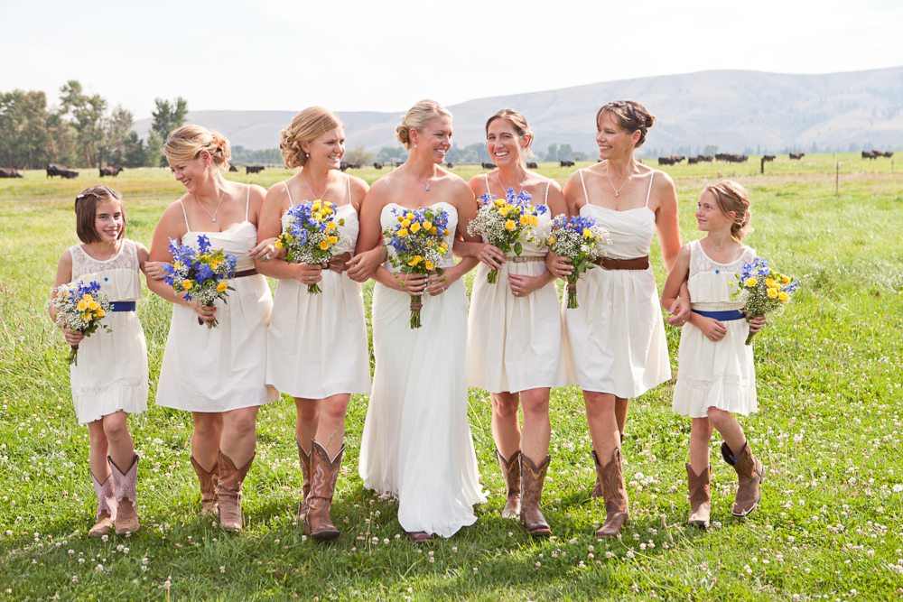 bride and bridesmaids walking through field - ellensburg wedding photographer