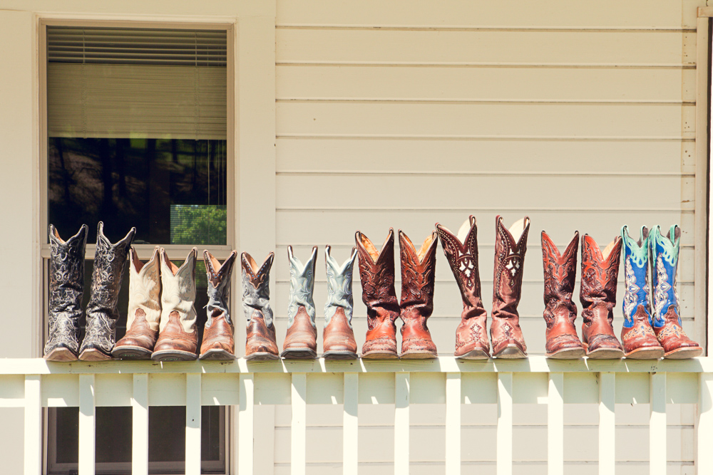 Brides and bridesmaids cowboy boots - rustic Cle Elum wedding at the Cattle Barn by Hailey Haberman Photography