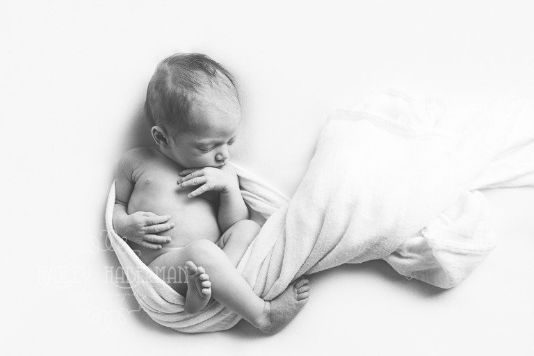 Newborn Baby Nola in natural pose in black and white