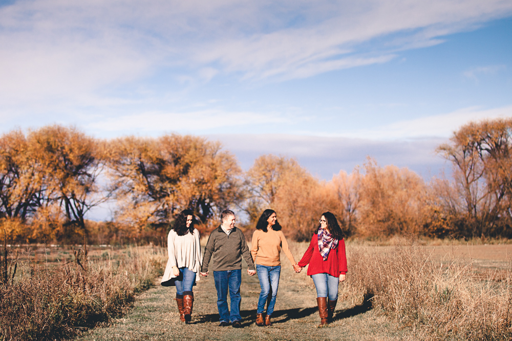 family of 4 with teenagers walking in fall landscape - lifestyle family photographer in ellensburg