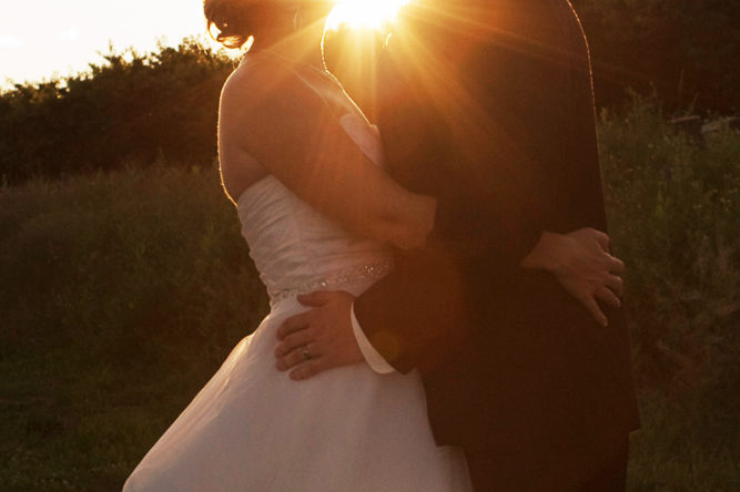 bride and groom kissing at sunset - fontaine estates wedding photographer
