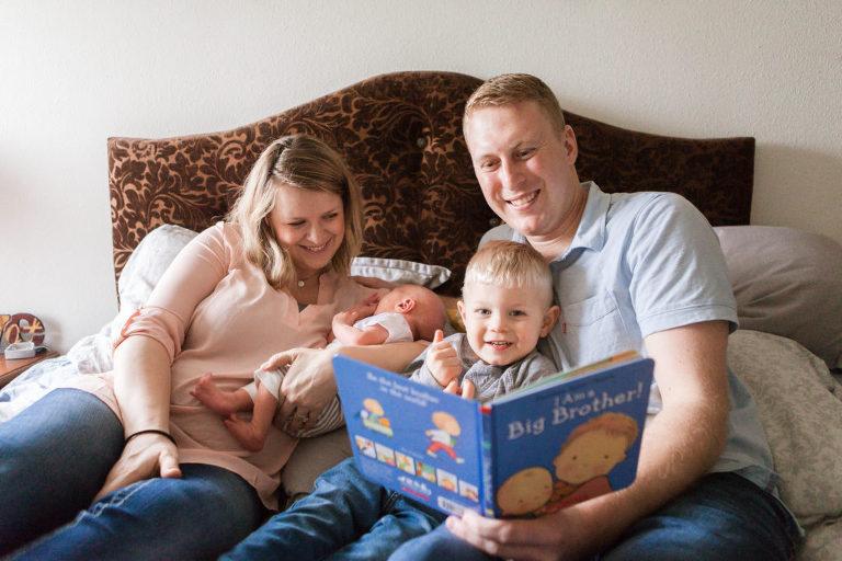 Family reading book to Baby Miles Ellensburg Lifestyle Newborn Photographer Hailey Haberman