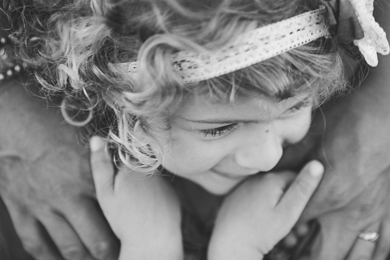 toddler holding mamas hands, Ellensburg Maternity Session with Megan & Kyle at Olmstead State Park in Ellensburg WA by Hailey Haberman Lifestyle Family Photographer