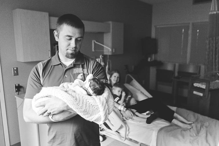 dad holding new baby in hospital, Baby Callie with Ellensburg Lifestyle Newborn photographer Hailey Haberman in Ellensburg WA