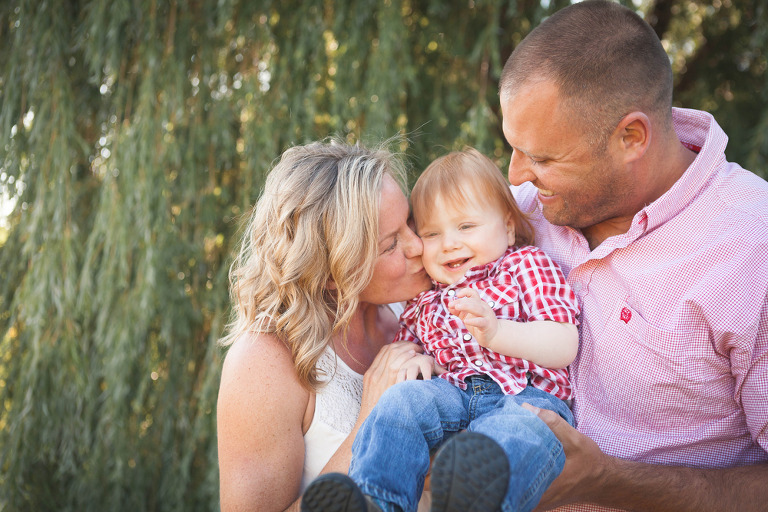 baby snuggled with parents, Rhett Turns One- lifestyle Family Session by Hailey Haberman in Ellensburg WA
