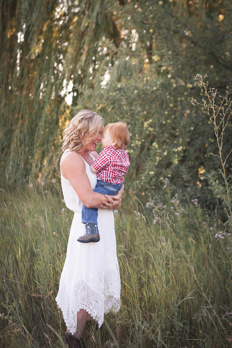 mama snuggling baby, Rhett Turns One- lifestyle Family Session by Hailey Haberman in Ellensburg WA